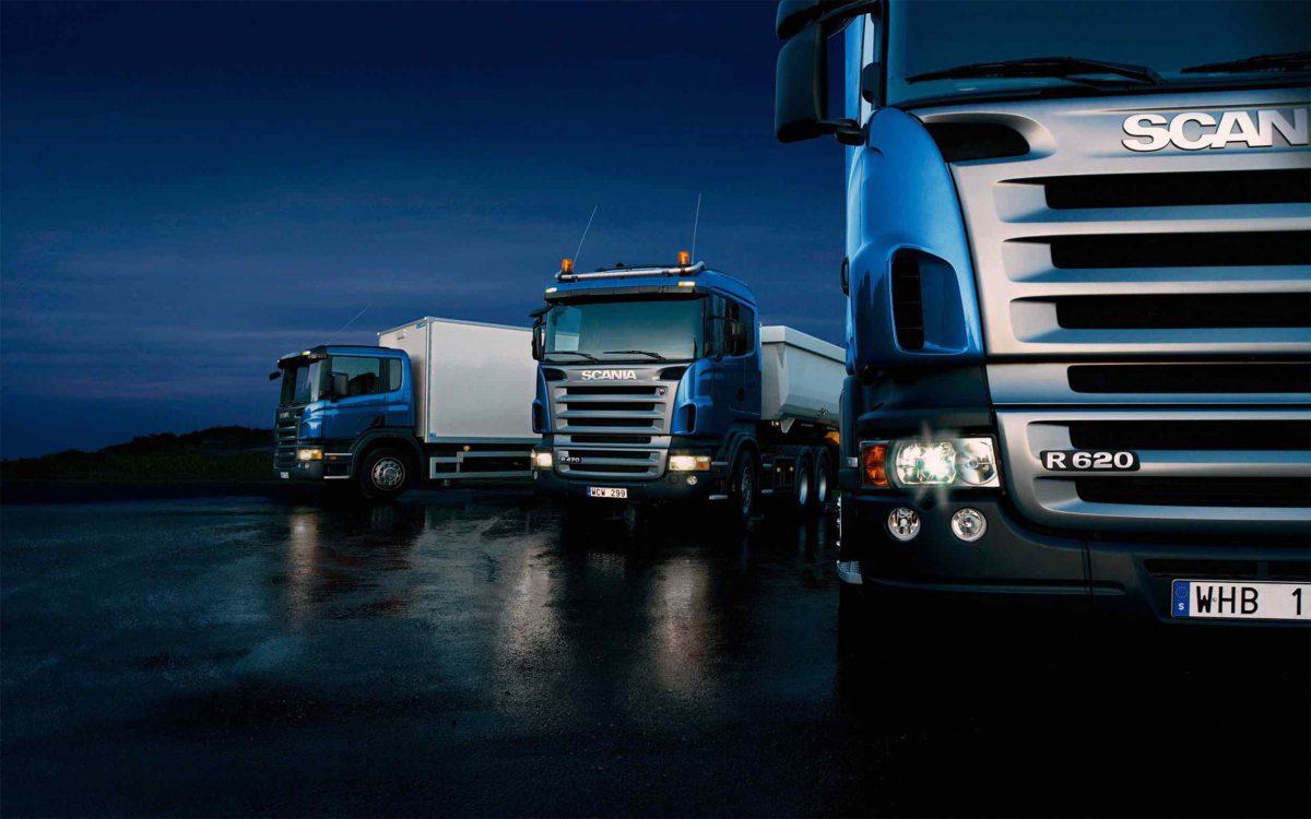 Three-trucks-on-blue-background